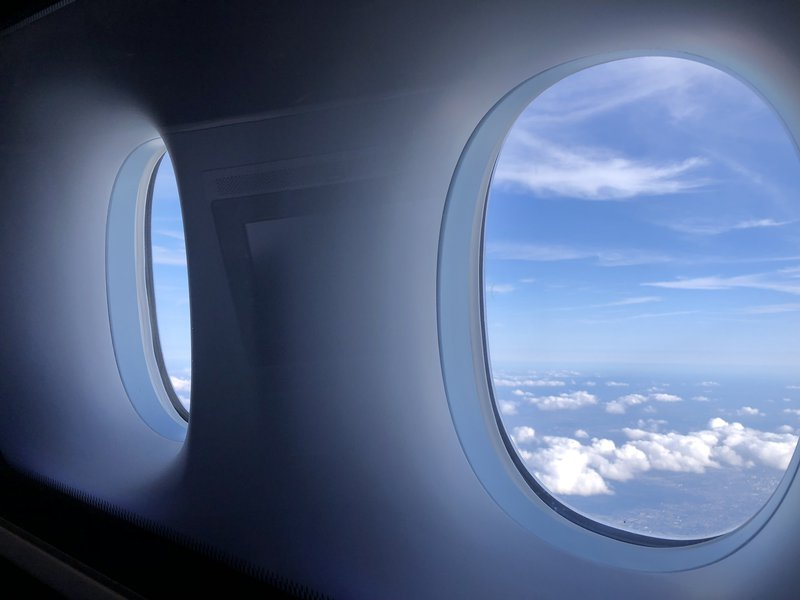 A window seat will snag you not one, but two windows to peek out of.