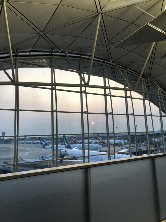 The sun sets on Hong Kong International Airport, one of the best airports to transit through.