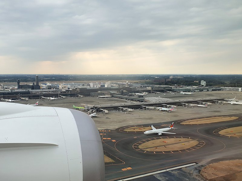 On our final approach to Narita with a Philippines Airlines A330 taxiing below.
