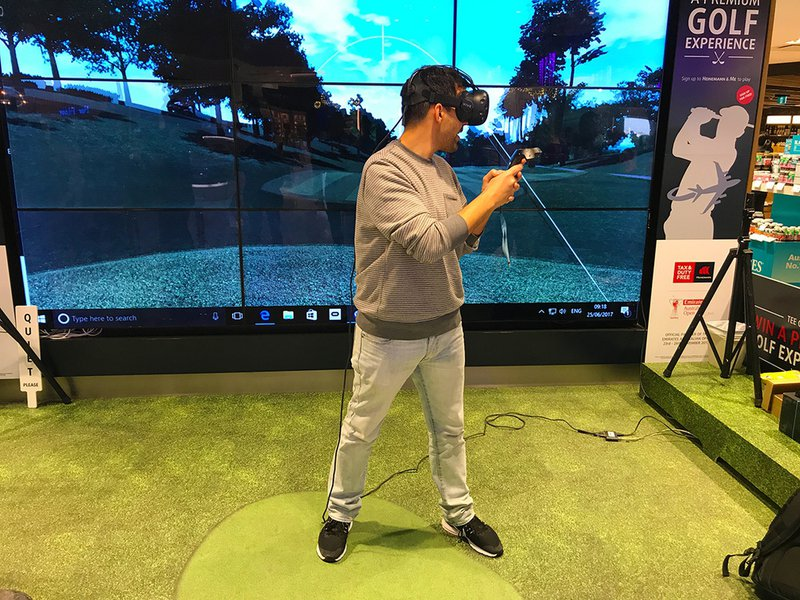 Leo trying out the VR golfing experience at Sydney International Airport.
