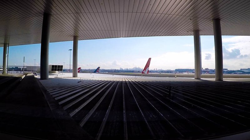 The iconic Sydney skyline from inside the Qantas Business Lounge at Sydney International Airport. The tail of the my American Airlines Boeing 787-9 Dreamliner is just visible in the middle.
