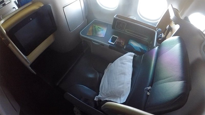 The Qantas Business Suite seat reclined.