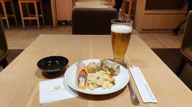 My main, beer, chicken wrap, conger eel sushi balls, shumai pork dumplings and shrimp cream macaroni gratin.