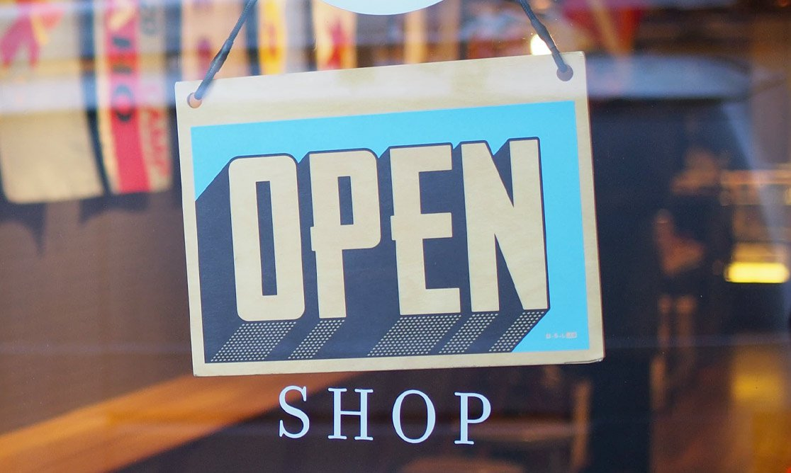 Open for business sign on the door