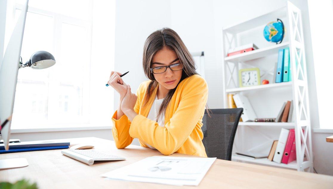Woman analysing bills